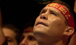Mexico's Julio Cesar Chavez, sings before his final bout May 22, 2004 at Plaza Monumental, the world's largest bull-fighting ring., in Mexico City. Julio Cesar Chavez ended his career with a victory Saturday night, outpointing old nemesis Frankie Randall. (AP Photo/Marco Ugarte)