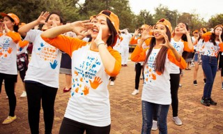 """Fifty boys and girls of various ages wearing the orange Strong Hands t-shirts and caps put on a flash mob dancing in sync.  It was one of the events that took place at the National University of Lao, Dong Dok campus on December 4th. It was a joint collaboration amongst UN Women, UNFPA, NCAW, NUOL, Fanglao and Hoppin. """"It is important for boys to respect girls because girls support us in everything we do, our Mothers have taken care of us, we have to do our part to take care of them."""" - Kaka, Director/Choreographer of Fanglao/Hoppin  Photo: DANHO/Daniel Hodgson"""