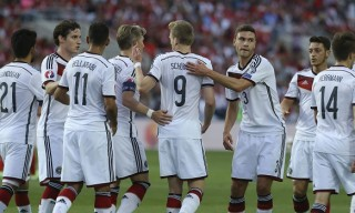 Germany's Andre Schurrle, center is congratulated by team mates after scoring the opening goal during the Group D, Euro 2016 qualifying soccer match between Gibraltar and Germany at the Algarve stadium, outside Faro, southern Portugal, Saturday, June 13, 2015. (AP Photo/Francisco Seco)