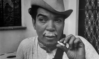 Mexican Actor Cantiflas, smoking a cigar