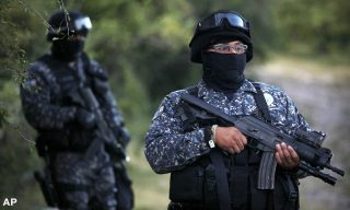 Mexican navy marines and officers belonging to the Attorney General's Office, guard the area where new clandestine mass graves were found near the town of La Joya, on the outskirts of Iguala, Mexico, Thursday, Oct. 9, 2014. Two weeks after 43 students disappeared in a confrontation with police in rural southern Mexico, Attorney General Jesus Murillo Karam announced that suspects had led investigators to four new mass graves near the southern city of Iguala where authorities unearthed 28 badly burned bodies last weekend. (AP Photo/Felix Marquez)